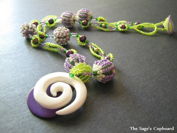 Spring Goddess Tagua Pendant. Custom Beaded Necklace in Green, Purple, and Natural Bone - Reserved