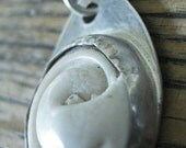 Ivory Sea Shell encased in Sterling Silver Necklace
