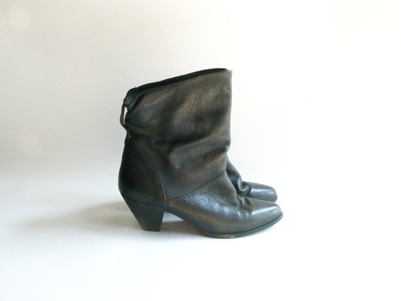 1980s boots black leather high heel slouch by tobedetermined