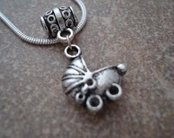 Necklace with Baby Carriage Pendant. Comes with silver plated snake chain. (C-416)