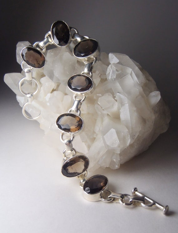 Elegant Smoky Quartz Crystal Bracelet.  Oval Faceted Stones and Silver Bezel Settings.  Crystal Healing Jewellery )0(