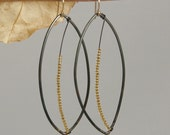Leafy Steel Dangle Earrings of Black Steel with Golden Leaf Veins