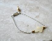 Dainty bracelet, sideways cross bracelet