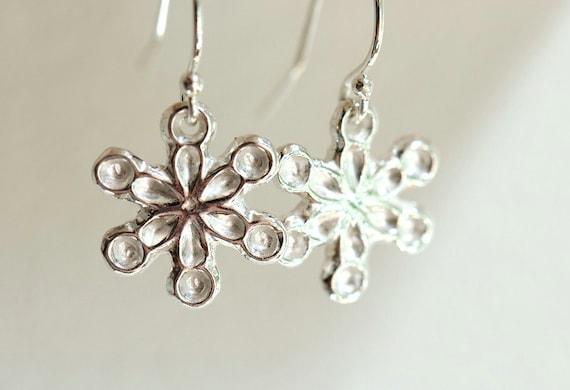 Snowflake earrings, sterling silver and fine silver dangke earrings. Winter jewelry. Christmas earrings.