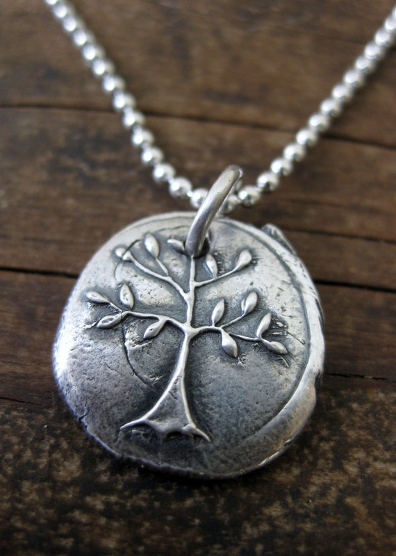 silver tree pendant symbol of strength and courage