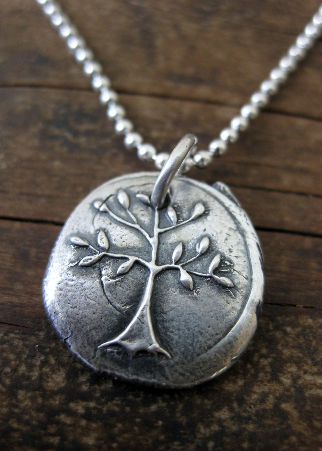 Silver tree pendant symbol of strength and courageSymbols Of Strength