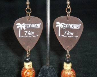 Earrings, dangle, light red guitar pick with wood beads