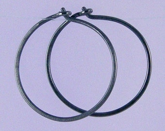 Small KISS hoops: Black niobium hoop earrings