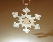 Sterling silver snowflake pendant with a 14K solid gold star