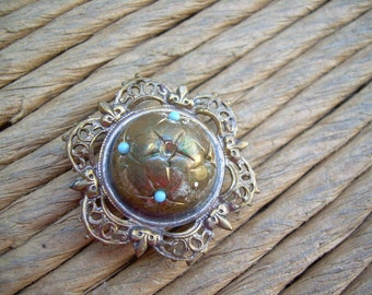 Antique Filigree Brass domed brooch with small Turquoise colored stones, Needs TLC Missing 3 small stones