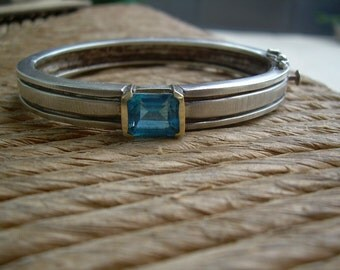 Stunning 925 SS and 18K Emerald cut Blue Topaz oval bangle bracelet with heavy duty safety clasp