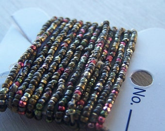 antique French steel cut bead Trim sold by the foot Copper Red and light green Facted metal beads