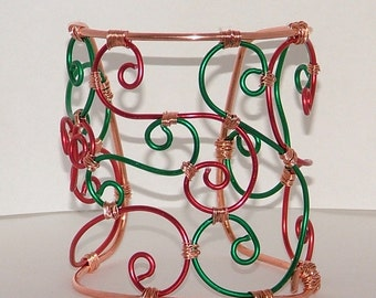 Copper cuff with red and green scrolls