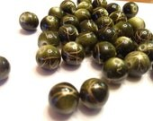 Green and gold patterned Wooden beads
