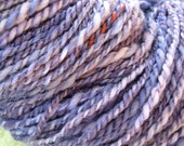 Hand dyed hand spun 2 ply textured yarn with lots of add ins