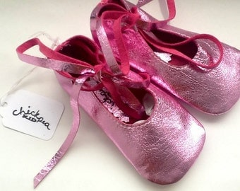 Pink metallic baby ballet shoes