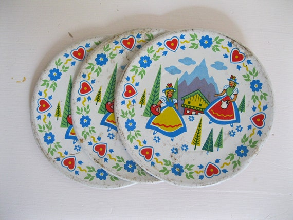 SALE....1950's Tin Toy Plates....Set of 3 vintage metal with litho.... Swiss Miss