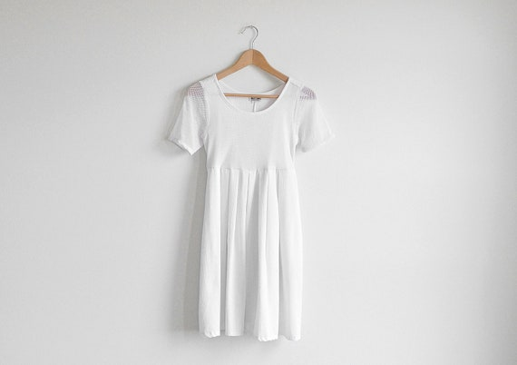 Vintage white mesh dress with a ribbon belt.