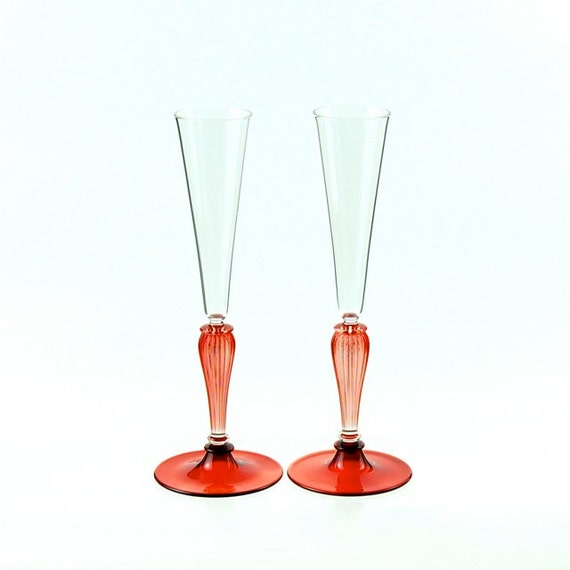 Champagne toasting glasses red and clear hand blown by kivaford - Hand blown champagne flutes ...