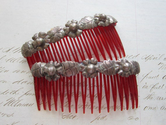 vintage Mexican silver hair combs - repousse floral design