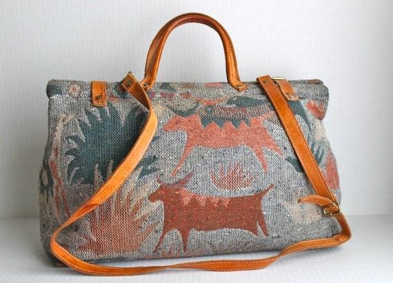 vintage framed carpet bag // leather buckle closures //  18x11x6