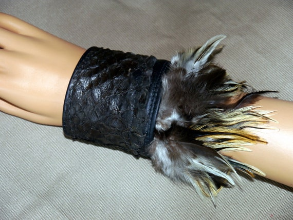 Leather and feather cuff bracer with python