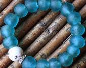 naga shell with rhinestone on blue glass...