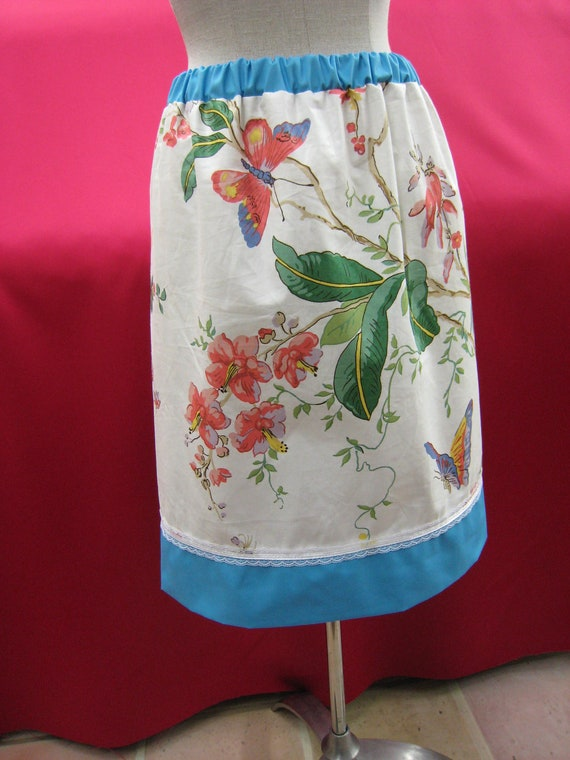Butterfly and floral print knee length skirt with light blue trim decoration plus made in USA