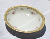 Lovely little vintage saucer with gold painted embellished edging and tiny little roses