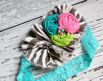 Seen and Herd- grey zebra print ruffle with lime, hot pink and teal rosettes