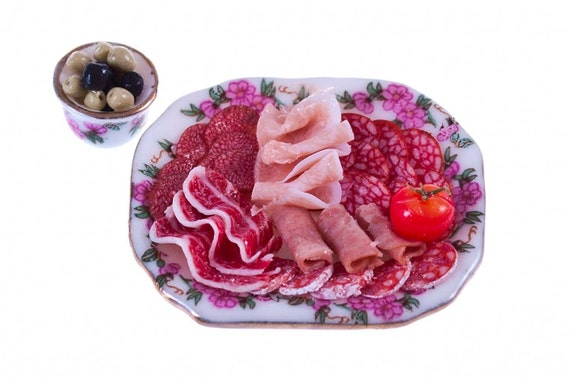 Deli meat platter with olives  miniature food