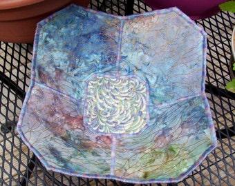 Decorative blue fabric bowl with chrysanthemum print