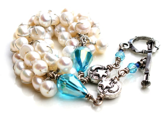 The snow white bracelet. white pearl wrapped bracelet. blue crystal. stars and moon beads