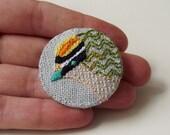 Firecrest Birdseeker Brooch. Linen.