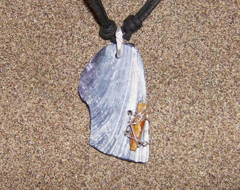 Light Wing- This Shell Amulet features a water polished Shell Fragment with a small blade of Orange Kyanite wired onto it