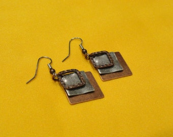 Angle of the dangle copper and silver earrings (Style #457)