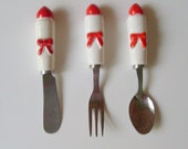 Vintage Christmas party serving knife or spreader, relish hors d'oeurve fork and spoon ceramic candle
