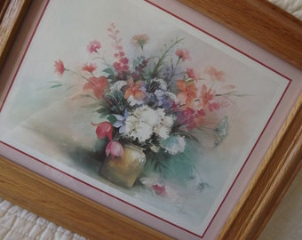 Vintage 1980s picture of flowers in a vase framed in a wood frame