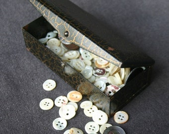 The fun retro button box. Vintage mother of pearl buttons collection.