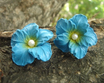 Blue Vintage acrylic flower earrings with detailed petals, yellow and faux pearl bead center