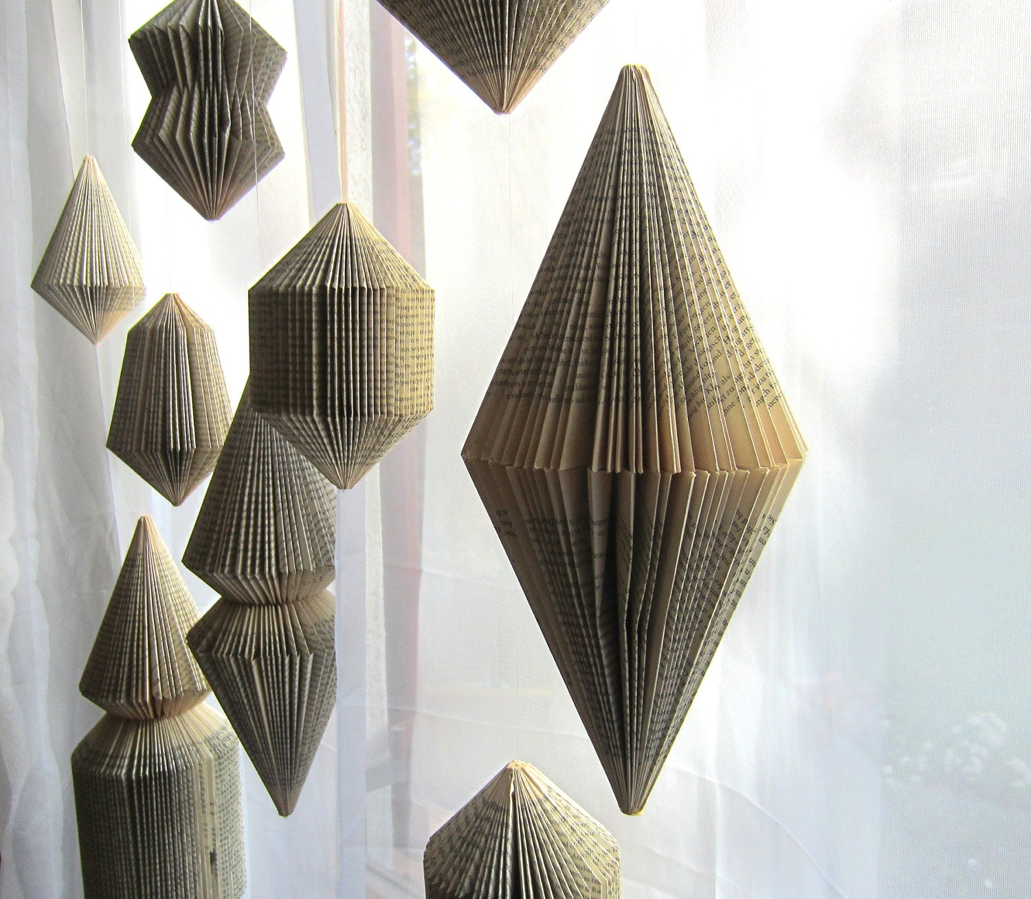 Hanging book sculpture bicone folded books for Art book decoration ideas