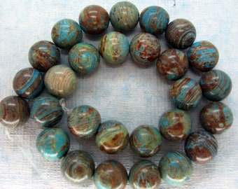 Natural Blue Sky Jasper Smooth Round Beads 14mm - 16 Inch Strand