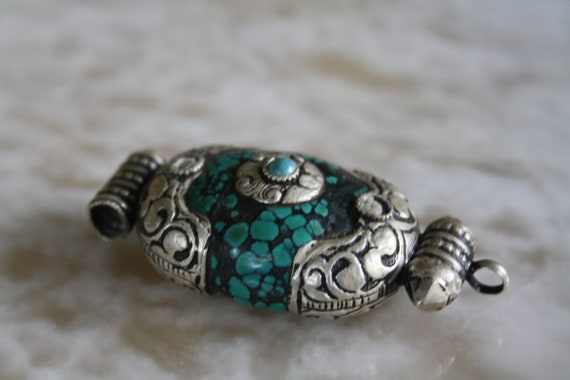 Turquoise Stone Surrounded by Silver Pendant
