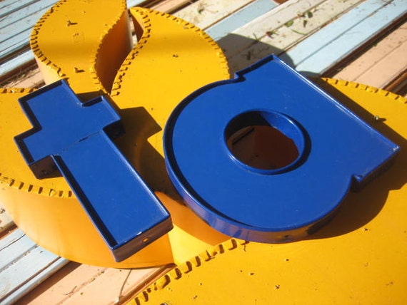 Small Blue Reclaimed Industrial Salvage Advertising Sign Letter: Translucent Plastic, Royal Blue Lowercase Initial 'T' or a Cross