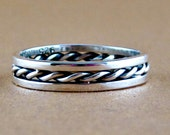Sterling silver band with a twist