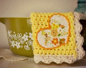 sweetheart, a scallop edged crochet potholder- heat pad- dishcloth