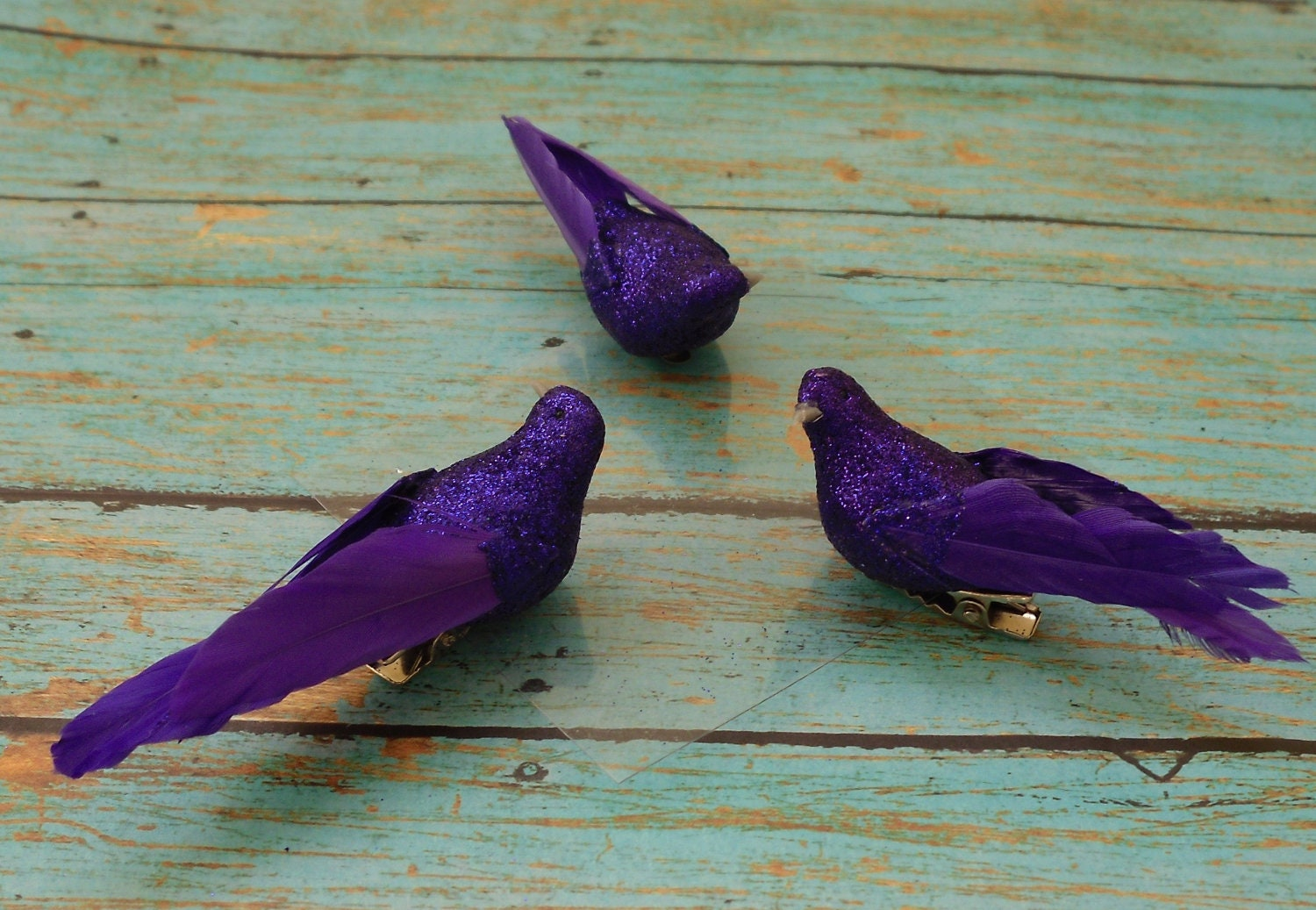 Three small artificial decorative purple birds on clips for Artificial birds for decoration
