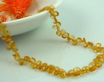 Dainty citrine faceted briolette beads 4-5mm 1/2 strand