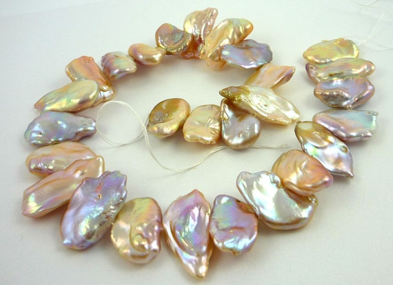 Exceptional multi colour platter/ coin pearls 24-32mm 1/2 strand