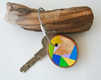 wood keychain with stainless steel cable wire, tones of yellow, green, lime and blue geometric triangle shapes keyring